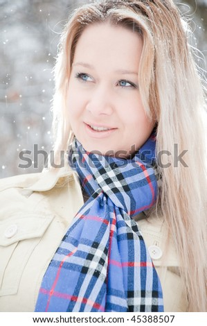 young girl in the snow in winter street