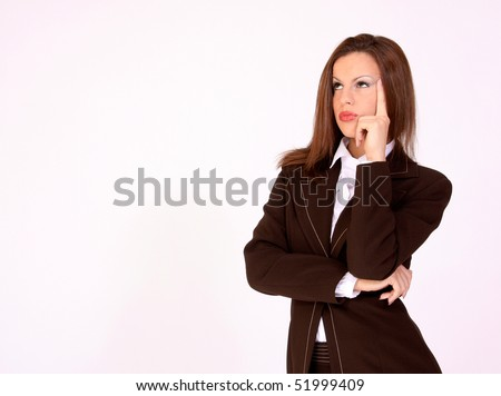 Young girl in thinking pose - stock photo