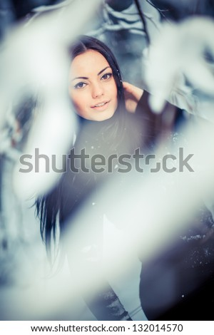 Young girl in winter forest