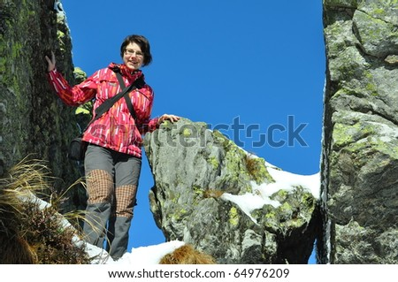young girl in winter mountains