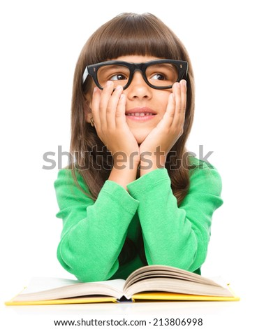 Young girl is daydreaming while reading book and wearing glasses, isolated over white - stock photo