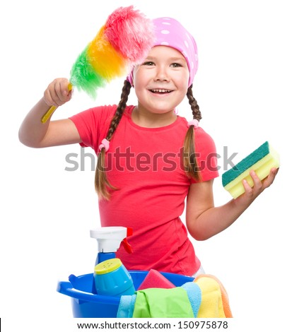 Young girl is dressed as a cleaning maid, holding static duster and sponge, isolated over white - stock photo