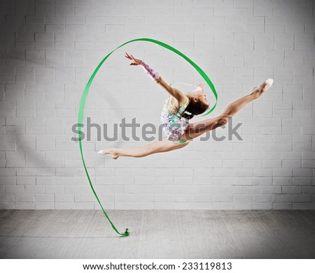 One caucasian woman exercising rhythmic gymnastics with ribbon in - Gymnastics Ribbon Stock Images Royalty Free Images