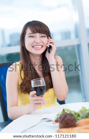 Young girl is happy to talk on the phone