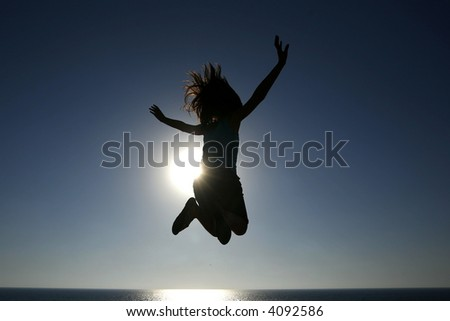Young girl is jumping in the air