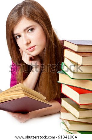Young girl is lying on a floor and reading book. Isolated on white background - stock photo