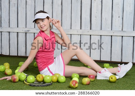Young girl is ready to play tennis - stock photo