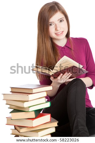 Young girl is sitting on a floor and reading book. Isolated on white background