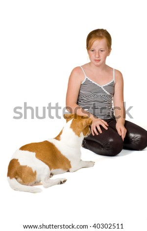 young girl is training a jack russel isolated on white - stock photo