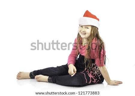 Young girl isolated on white wearing a santa hat