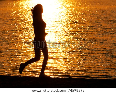 Young girl jogging on the beach