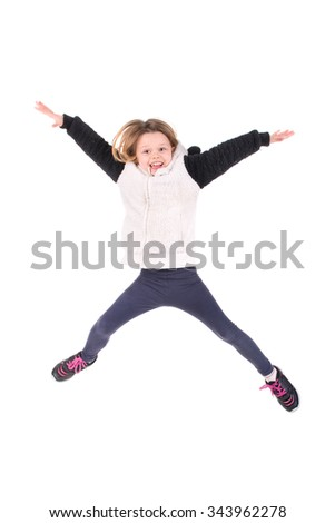 Young girl jumping isolated in white