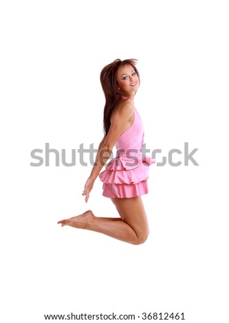 young girl jumping isolated on white