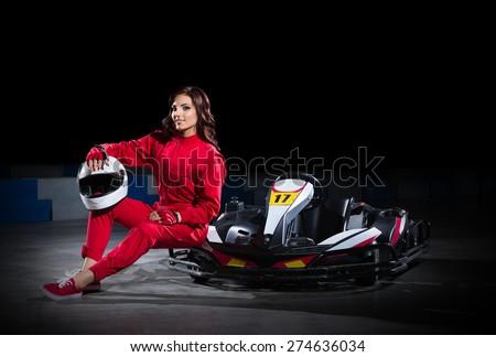 Young girl karting racer isolated - stock photo
