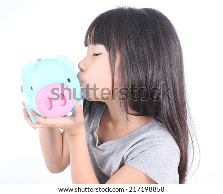 Young girl kissing piggy bank  - stock photo