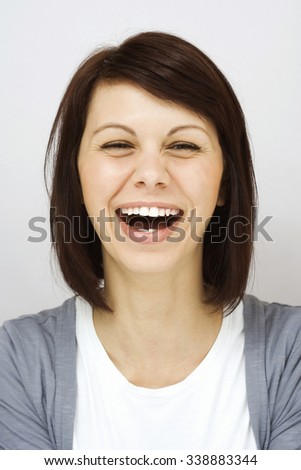 Young girl laughing sincerely