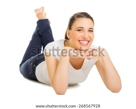 Young girl laying on the floor isolated - stock photo