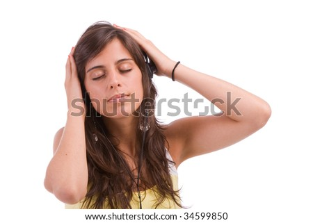 Young girl listening to music, isolated over white