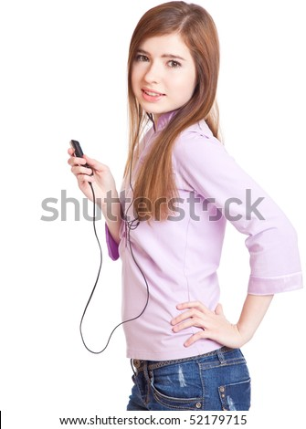 Young girl listening to music om mp3 player. Isolated on white background