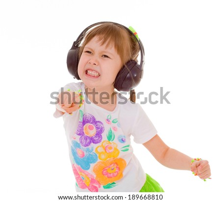 Young girl listening to music on headphones. Isolated on white background.