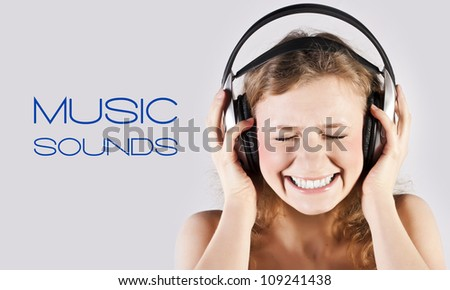 Young girl listens music in the studio - stock photo