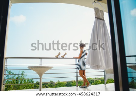 young girl looking at the beautiful views of the sea