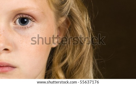 Young girl looking serious - stock photo