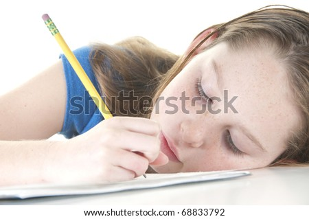 Young girl looking tired with school work