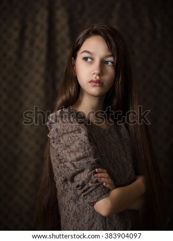 young girl looking to the side