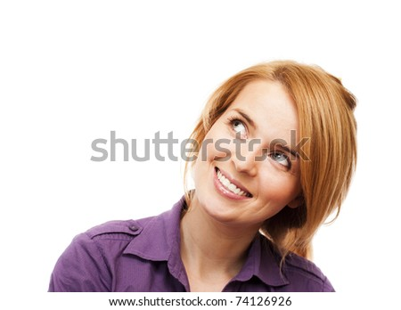 Young girl looking up - stock photo