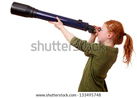 Young girl looks through a telescope on white background - stock photo