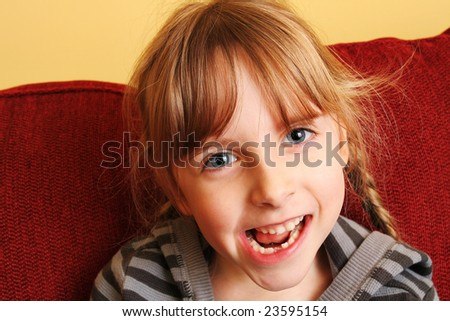 Young girl losing her first tooth - stock photo