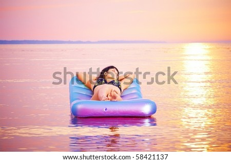 young girl lying down on the airbed