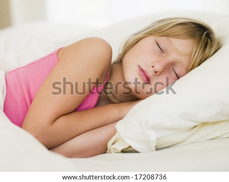 Young Girl Lying In Her Bed - stock photo