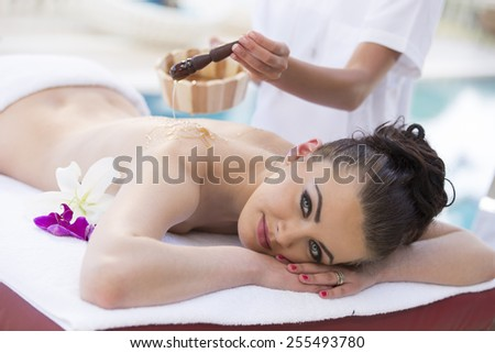 young girl lying on massage table for relaxation