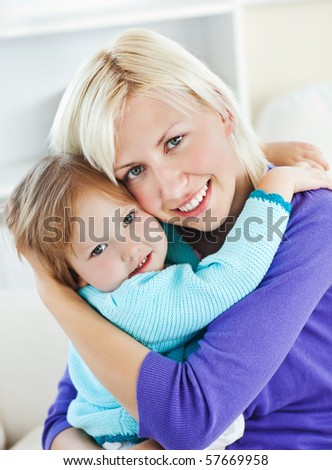 Young girl lying on sofa in living room - stock photo