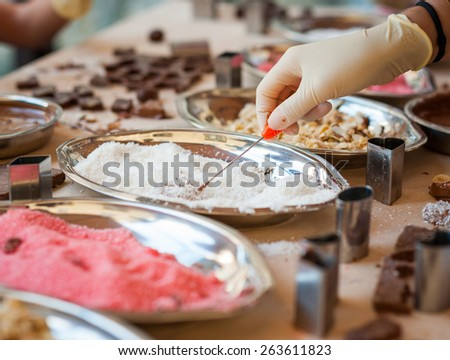 Young girl making chocolate candy