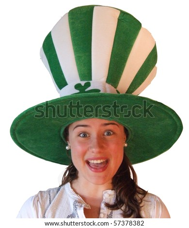 Young girl making funny face wearing Irish hat - stock photo