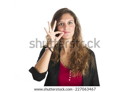 Young girl making silence gesture over white background