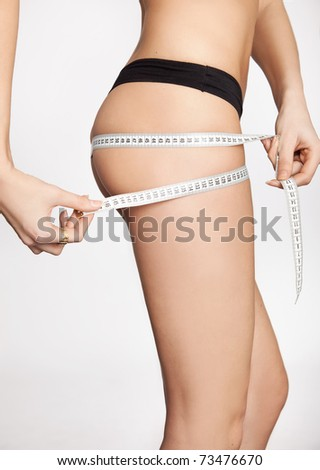 young girl measuring hip - stock photo