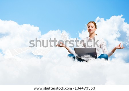 young girl meditating on the clouds with a laptop, dreaming at work