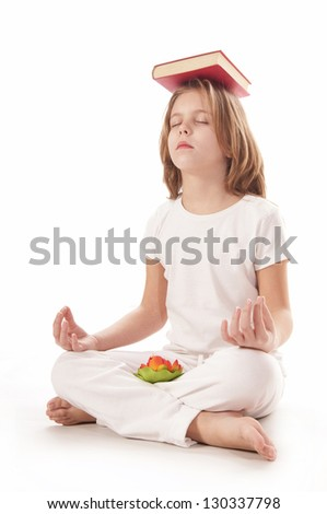 Young girl meditating witk red book - stock photo