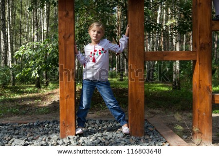 Young girl model posing in a forest - stock photo