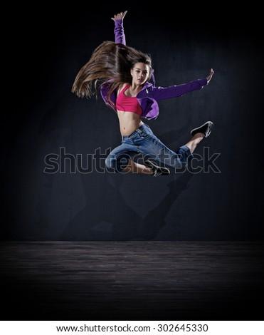 Young girl modern dancer (dark version) - stock photo