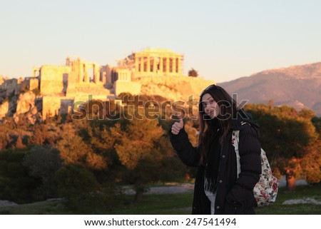 Young girl near firer sunset acropolis.Student in Athens,Greece. - stock photo
