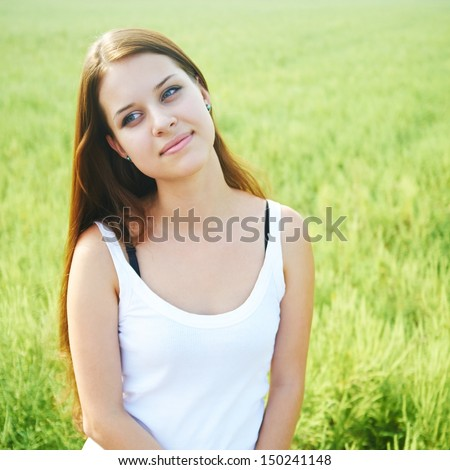 young girl on a background of grass.