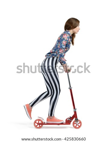 Young girl on a skateboard scooter isolated on white background - stock photo