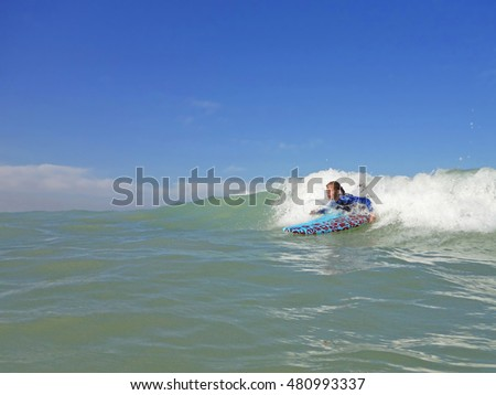 Young girl on surfboard