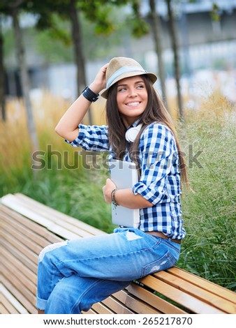 Young girl on the bench - stock photo