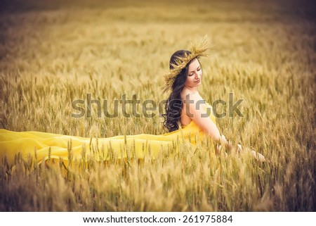 Young girl on wheat field  - stock photo